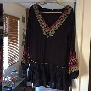 Free People black tunic . Never been worn, size XS